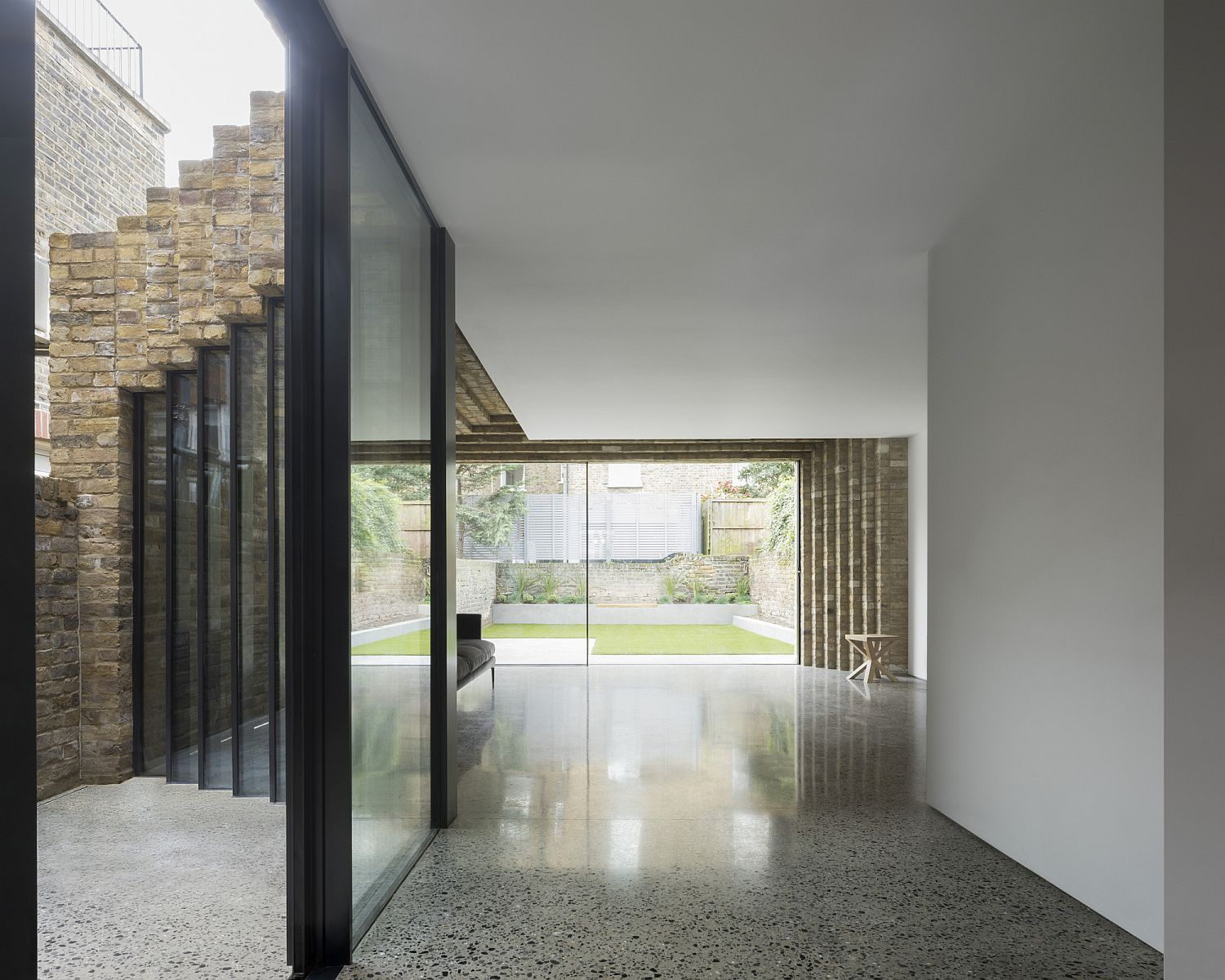 Sliding glass wall partition inside the house