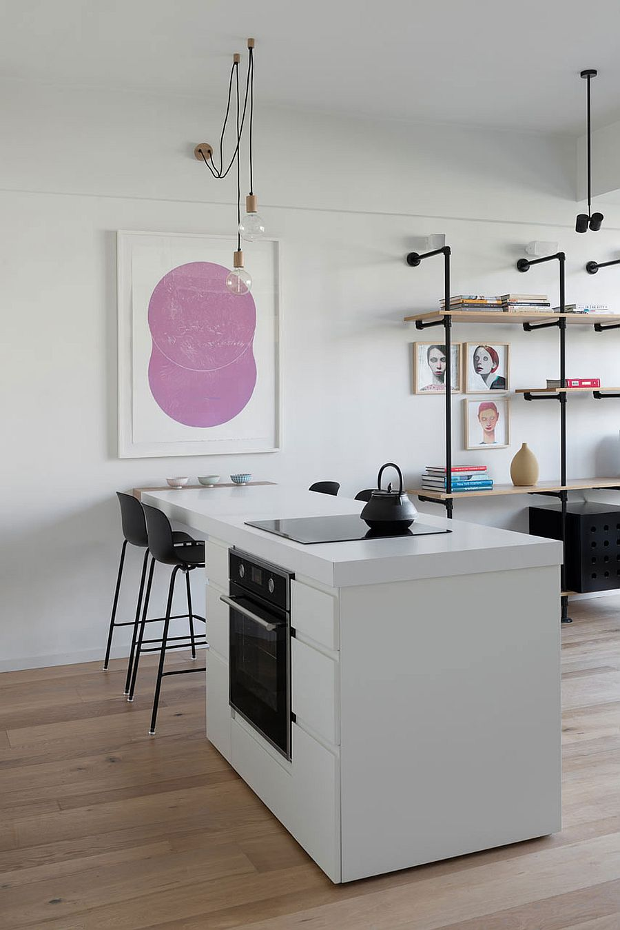 Small kitchen of the open plan living area in white
