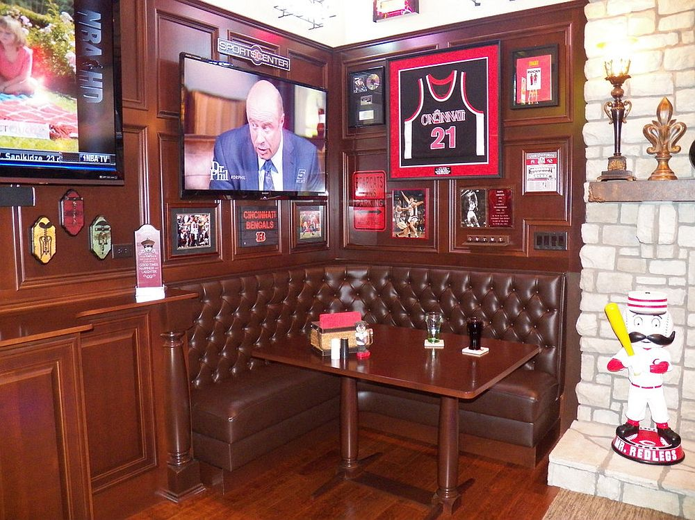 Small-nook-in-the-living-room-turned-into-a-media-room-with-sports-theme
