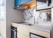 Small-single-wall-kitchen-with-bright-blue-cabinets-atop-217x155