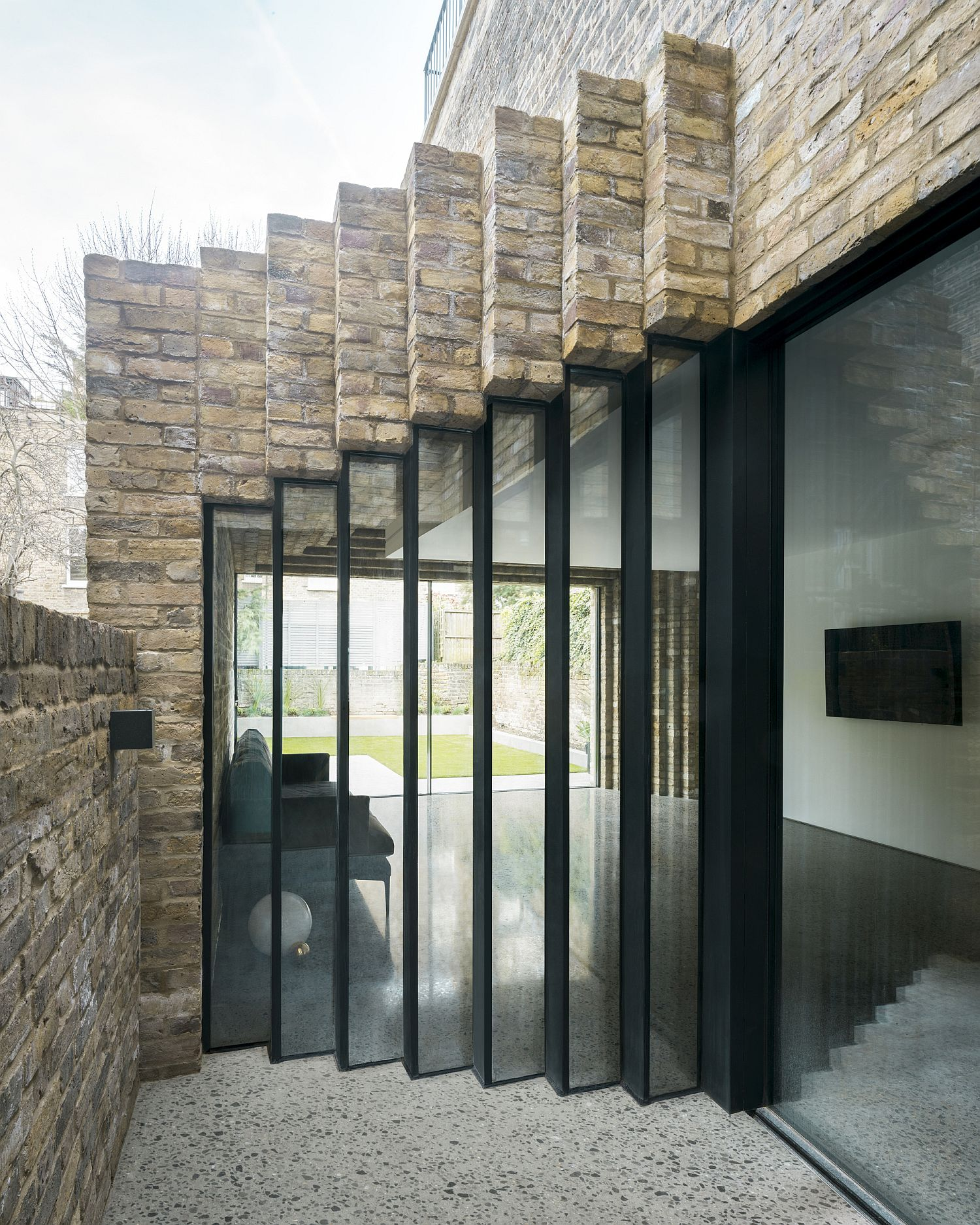 Smart staggered brick extension also brings in ample ventilation to the heritage home