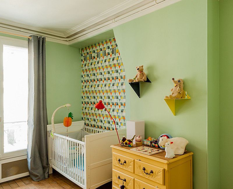 Space-savvy contemporary nursery with accent green wall
