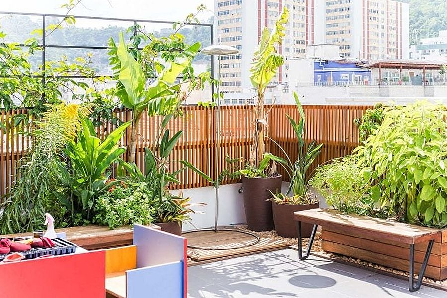 Spacious balcony outside with plenty of greenery