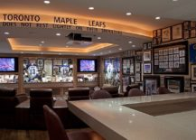 Sports-memorabillia-on-the-walls-is-perfect-for-the-stunning-home-theater-217x155