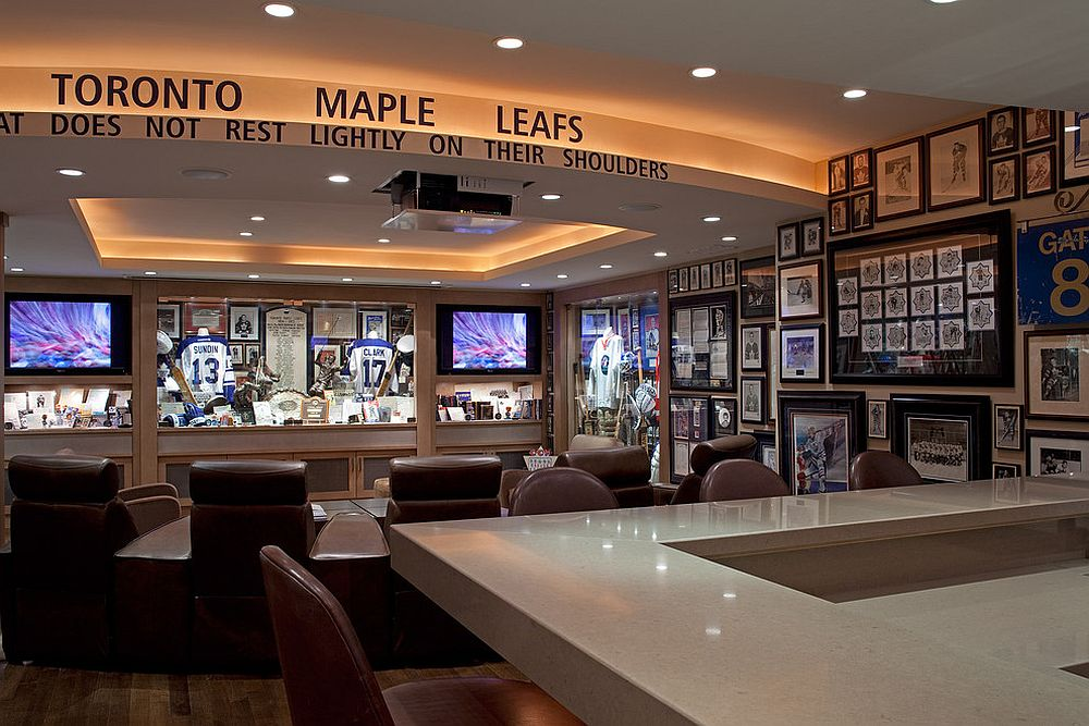 Sports memorabillia on the walls is perfect for the stunning home theater