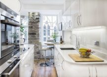 Stone-wall-section-adds-character-to-the-tiny-kitchen-in-white-217x155