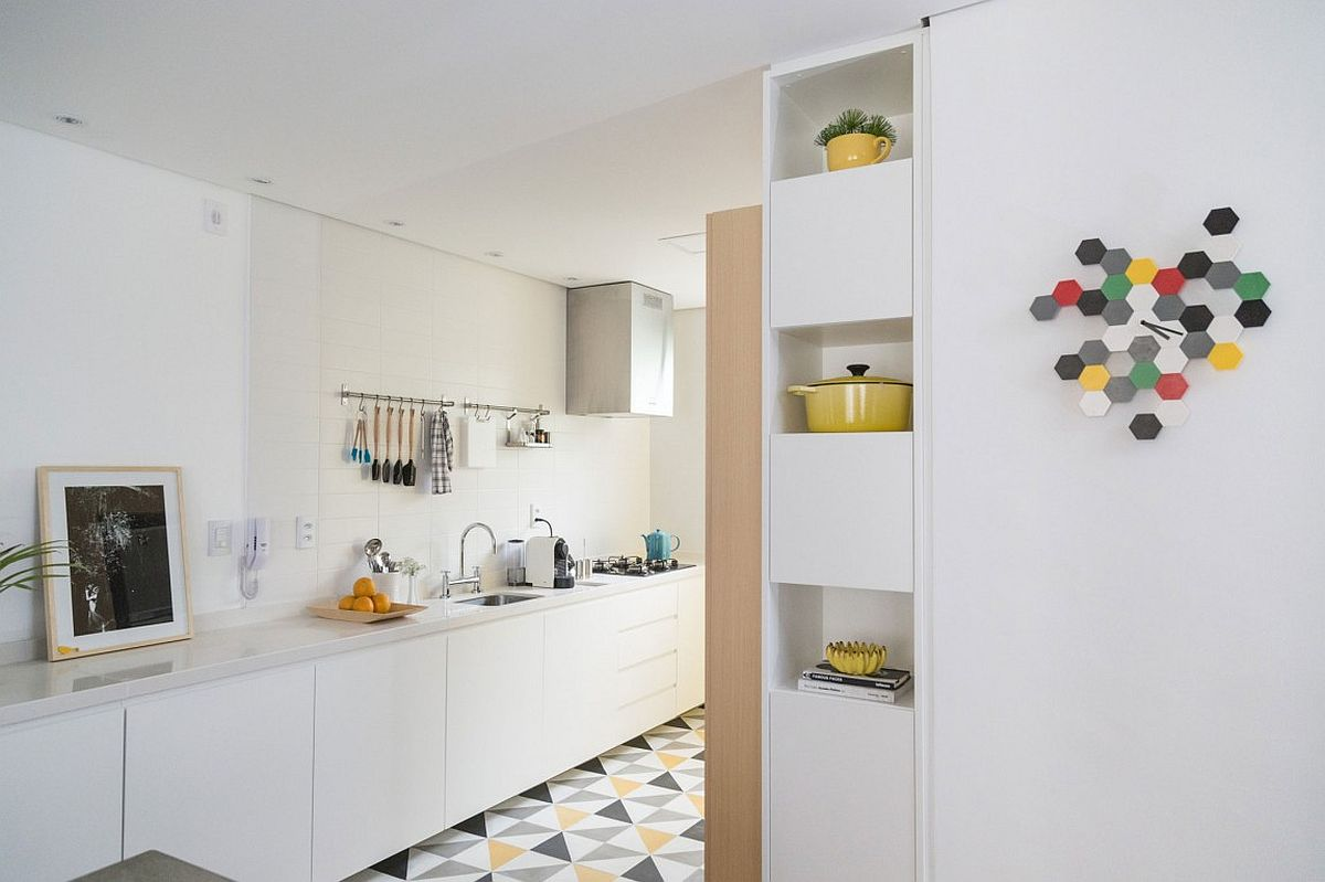 Stylish kitchen with geometric floor tiles for the small Sao Paulo apartment
