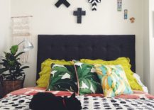 Throw-pillows-bring-bright-tropical-charm-to-this-bedroom-in-white-217x155