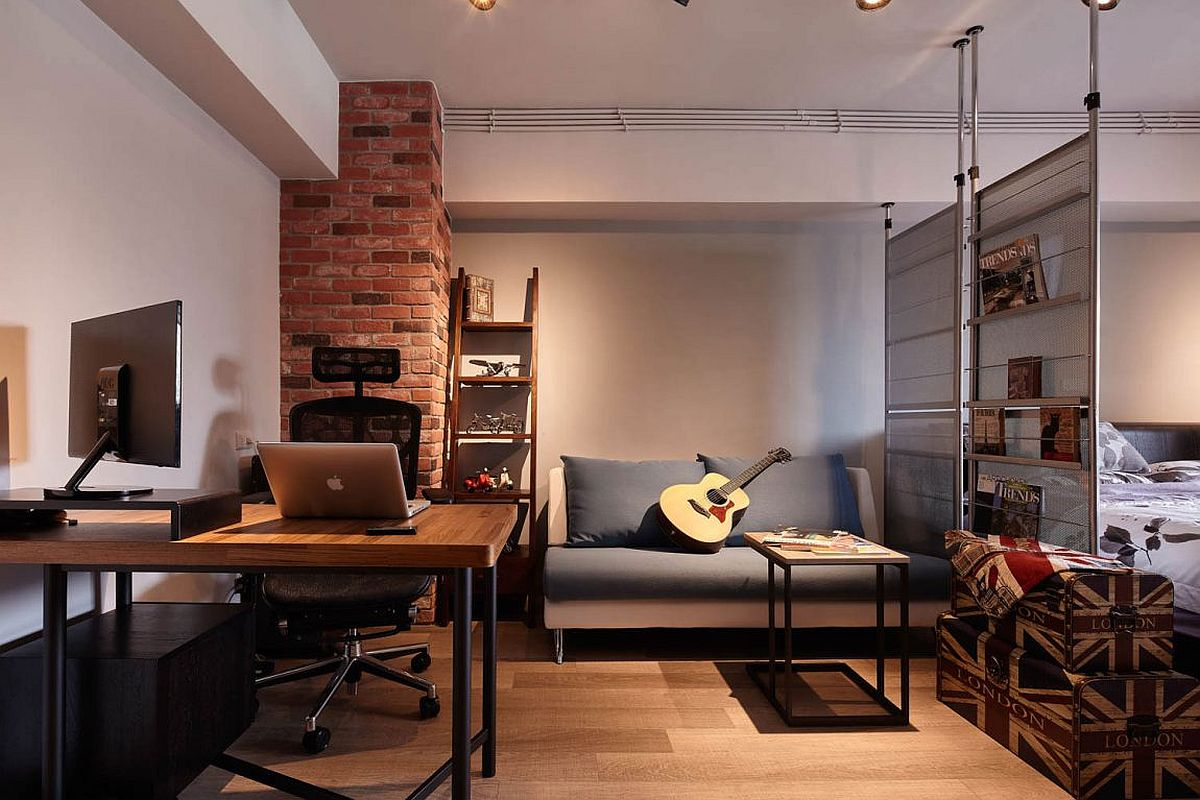 Tiny industrial loft style living room with brick wall section and ergonomic decor