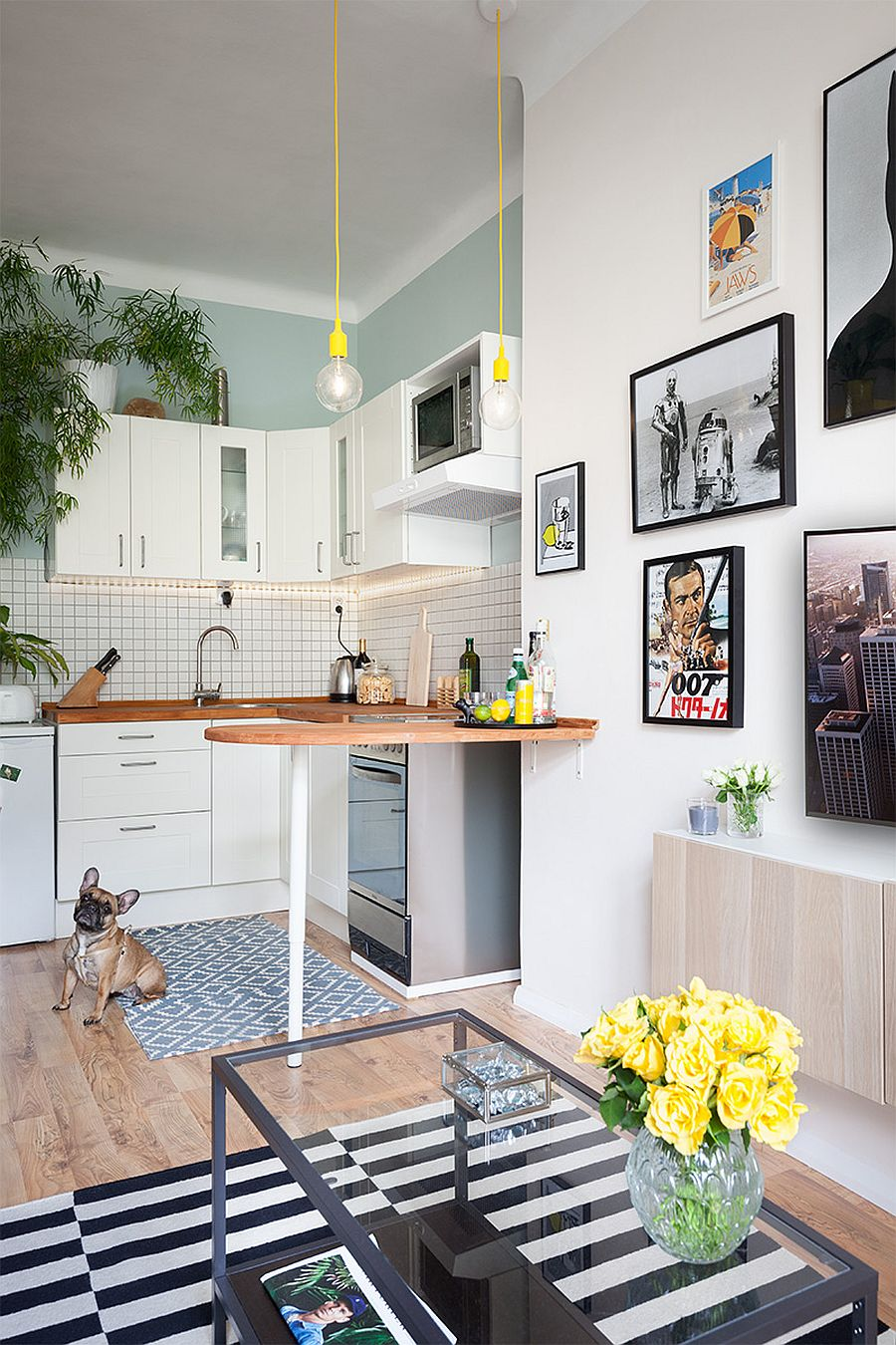 Tiny kitchen in white with pops of yellow to enliven it
