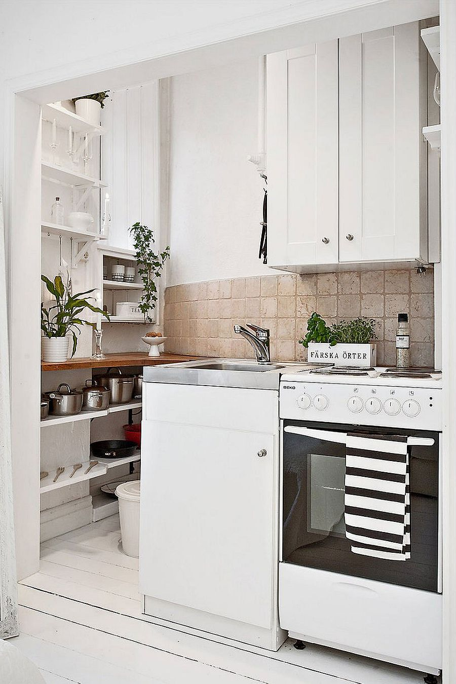 Tiny nook inside the Scandinavian apartment turned into space-savvy kitchen