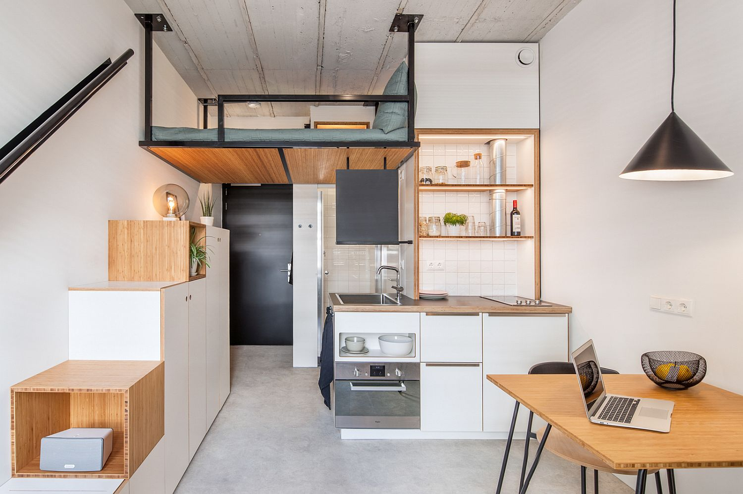Ultra-small student apartment living with loft bed above and steps with storage