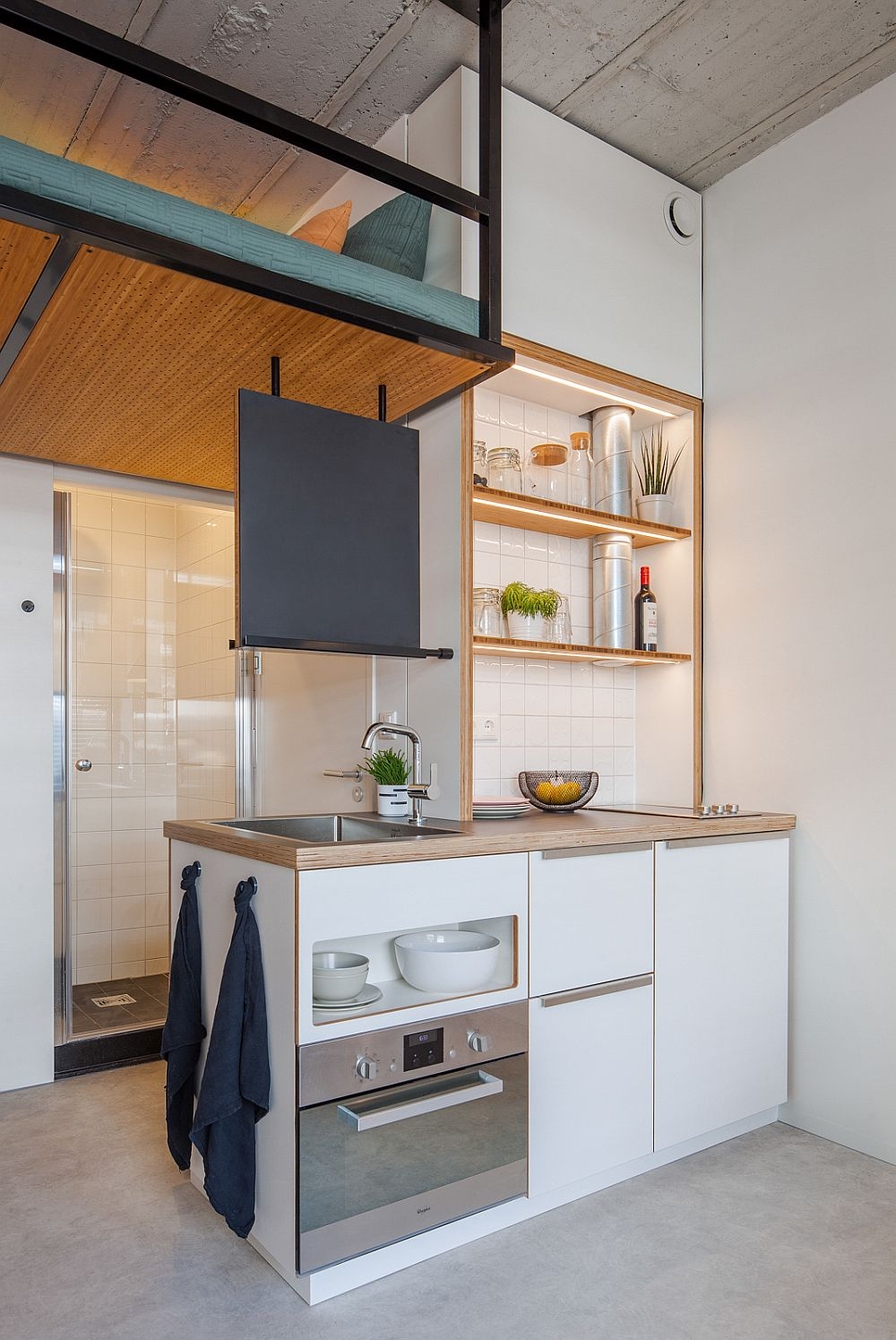 Ultra-tiny kitchen of the 18 square meter apartment is a master space-saver!