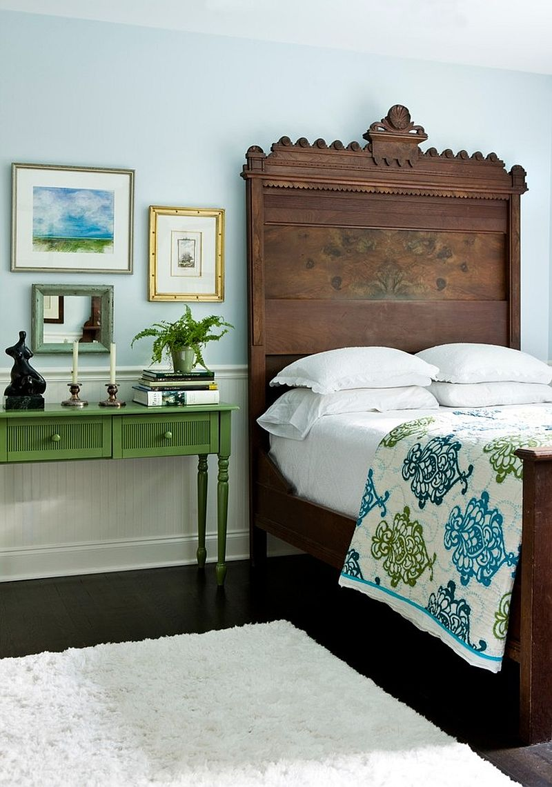 Vintage wooden bed for the eclectic bedroom in light blue