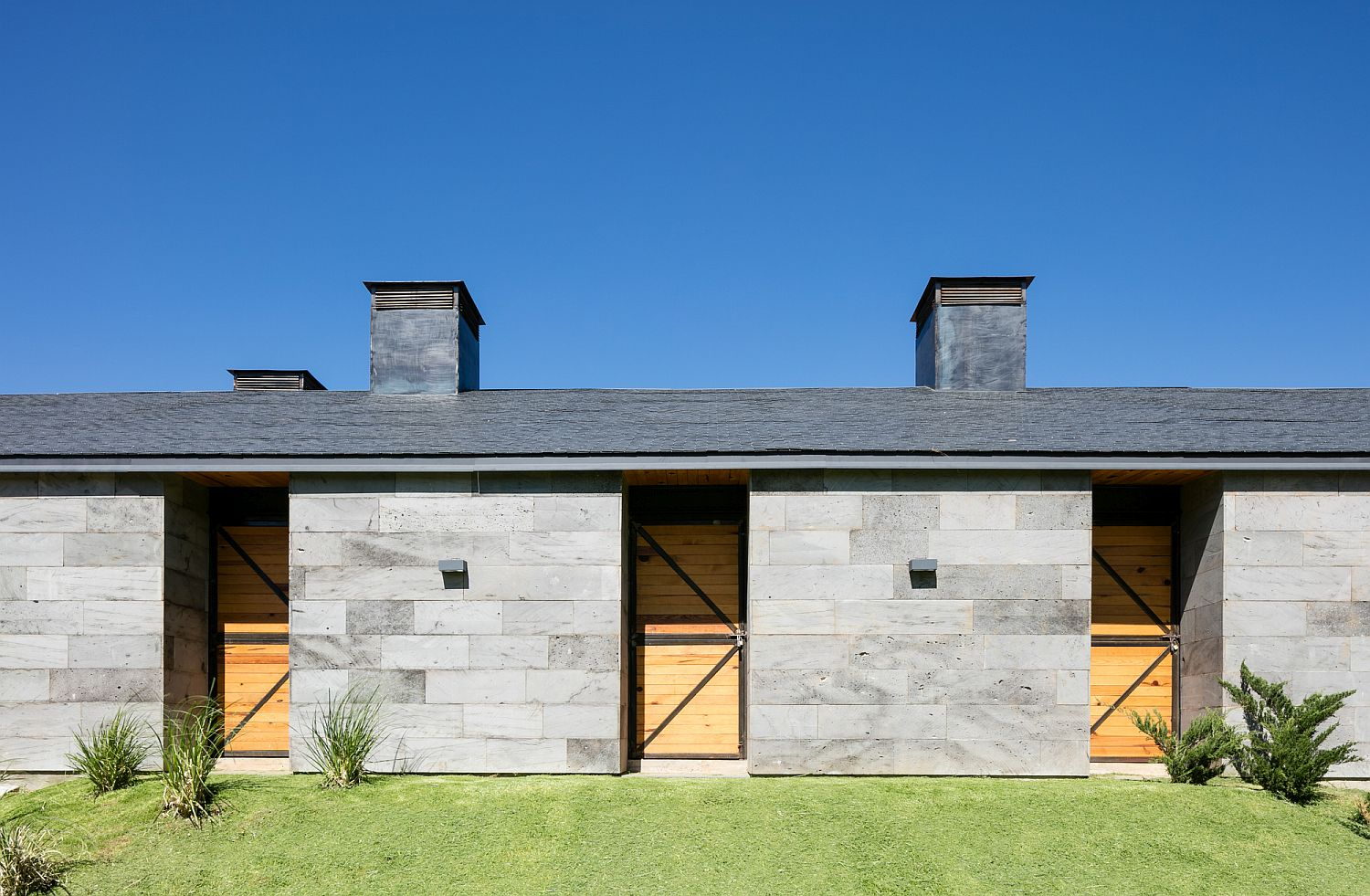 Volcanic rock gives the exterior a polished facade in gray