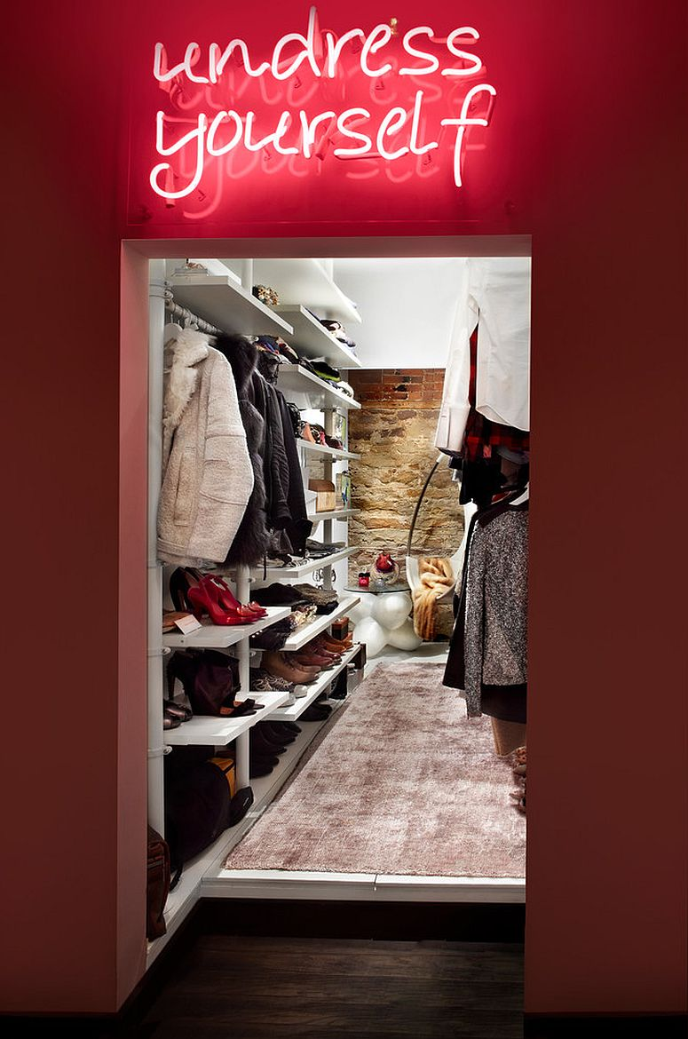 Walk-in-closet-with-an-illuminated-sign-that-says-undress-yourself