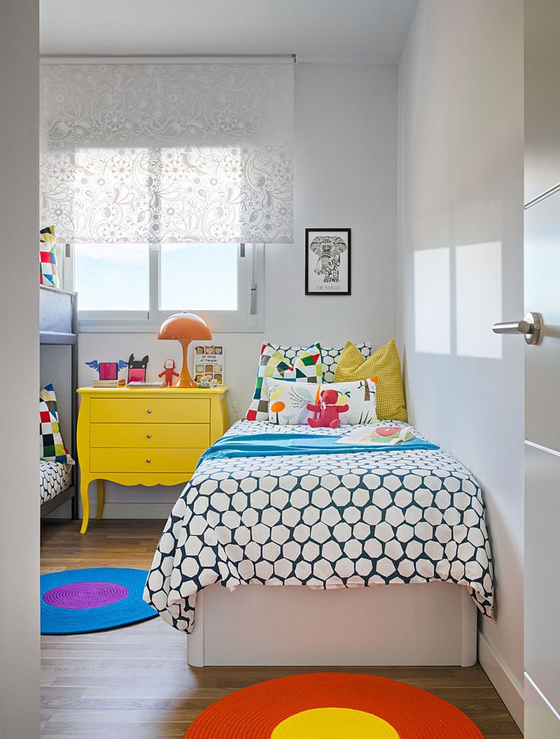 White kids' room with yellow, orange and blue accents