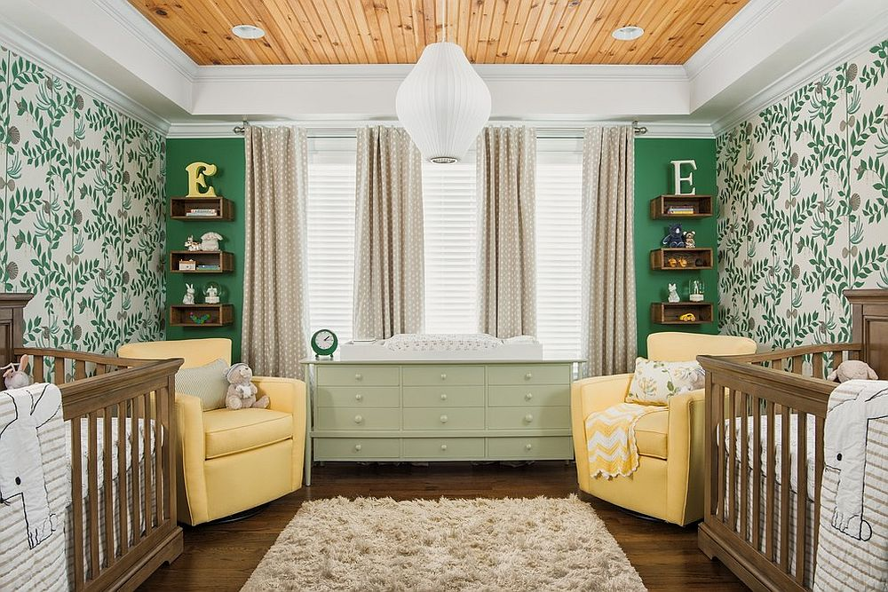 White nursery with green wallpapered and accent wall and wooden ceiling