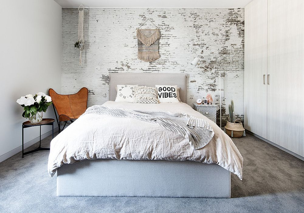 Whitewashed brick walls are a hit in the shabby chic bedroom