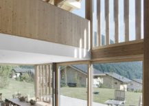 Wood-and-glass-shape-a-lovely-rear-facade-for-the-swiss-home-217x155