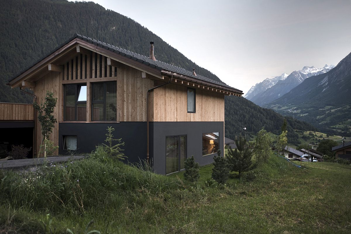 Wood and masonry shape the exterior of the home with a view of the valley
