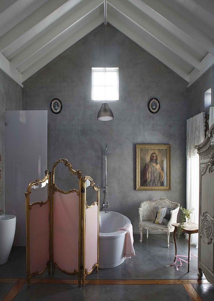 A touch of Parisian chic for the concrete walled bathroom makes it a show stopper!