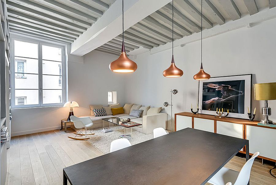 Beautiful copper pendant lighting for the dining area inside petite Paris apartment