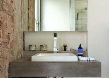 Concrete-is-combined-with-brick-beautifully-inside-this-modern-industrial-bathroom-217x155