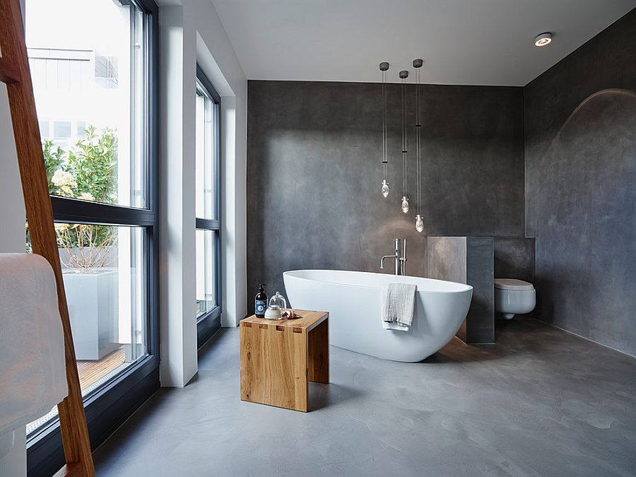 Contemporary bathroom with custom plaster finish that mimics concrete visually