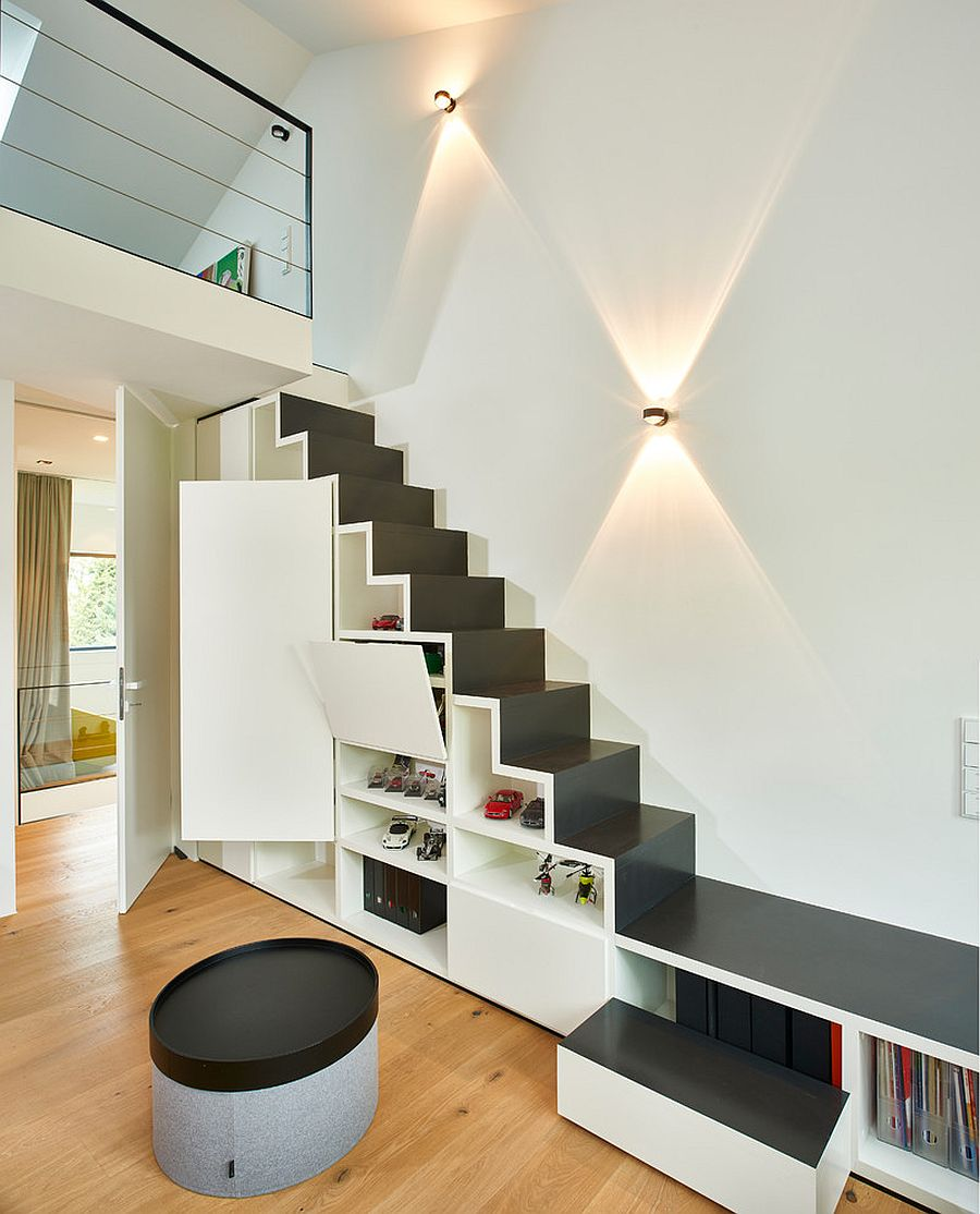 Contemporary stairway in black and white with shelving and cabinets
