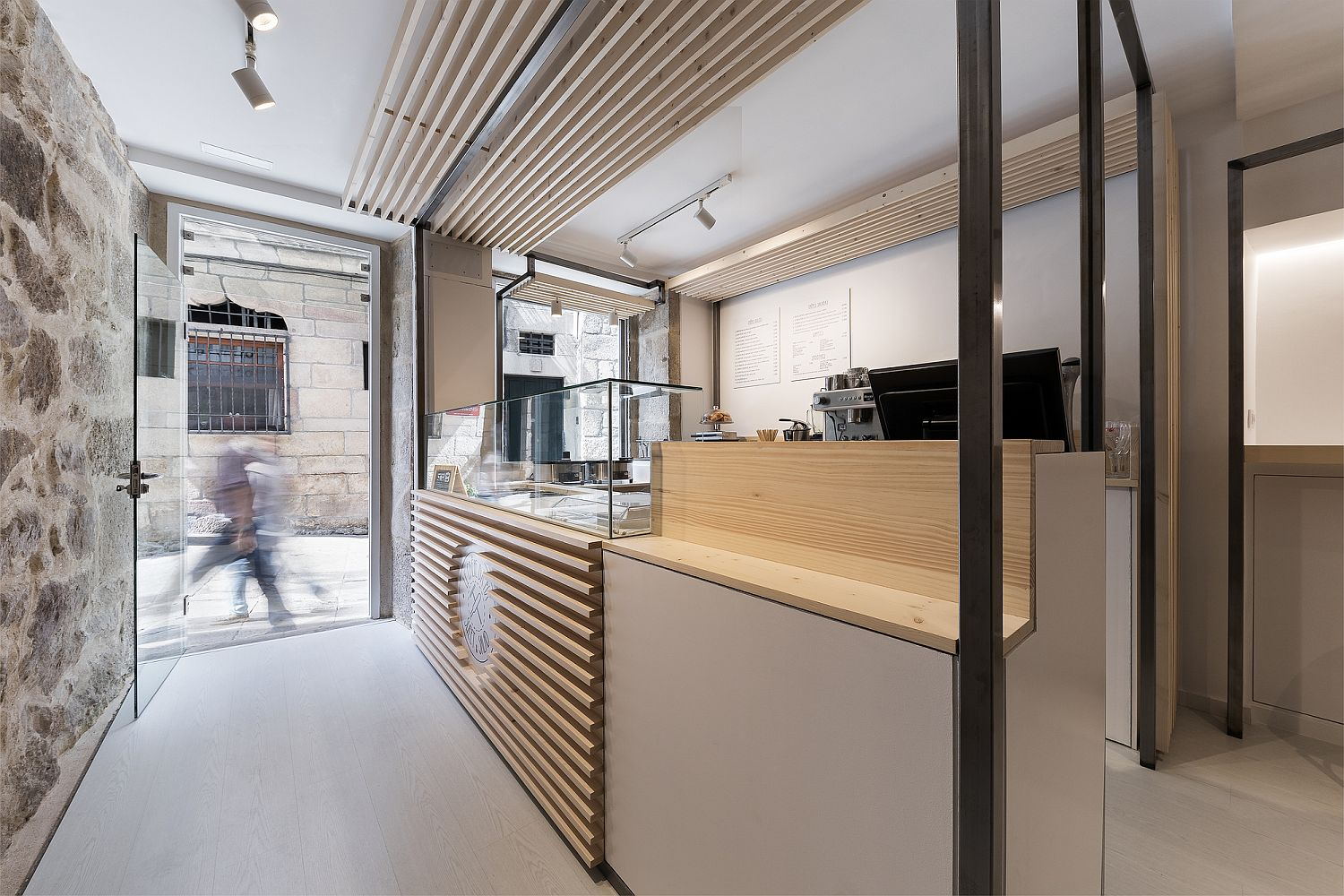 Counter at the start of the small restaurant that flows into the street outside