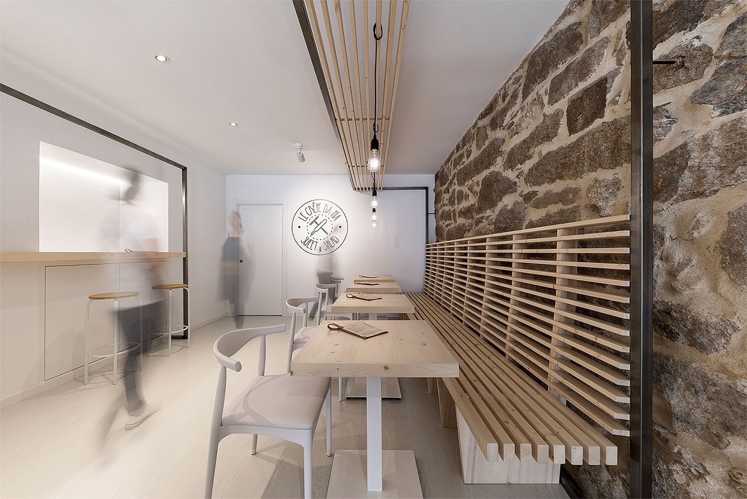 Cozy and space-savvy wooden seating inside the tiny Spanish restaurant