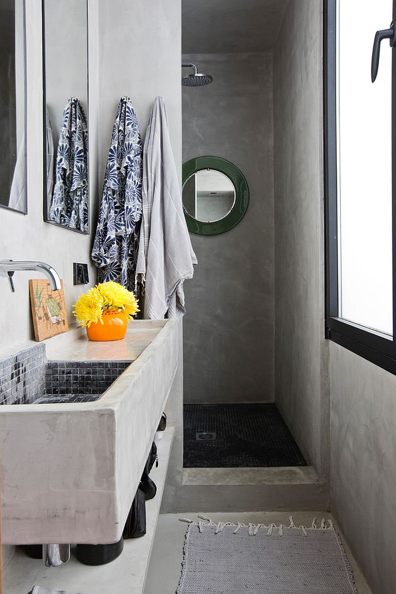 Dashing concrete walls add to the black and white appeal of this bathroom