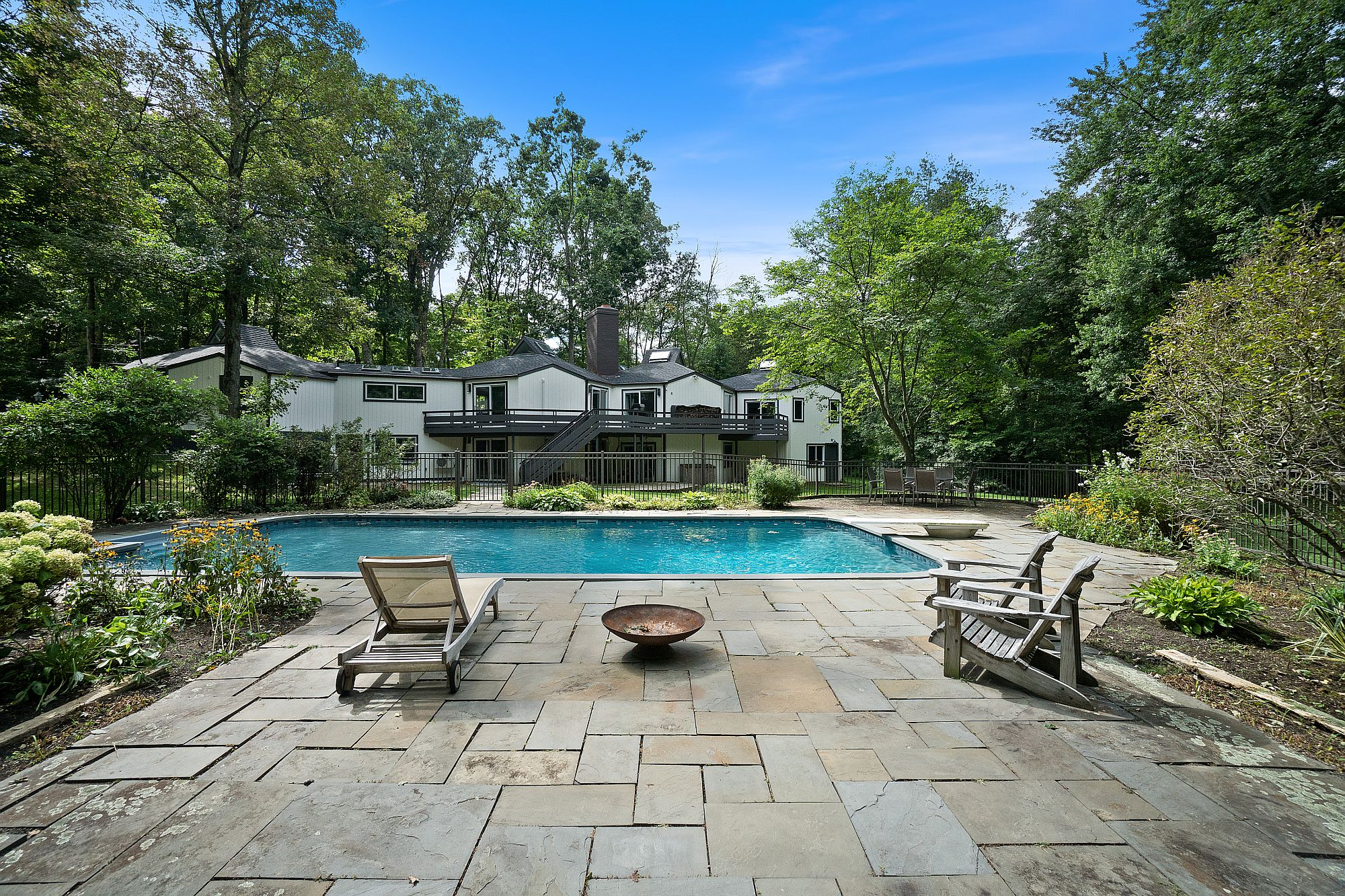 Expansive Deck Garden And Pool Area Of The Contemporary