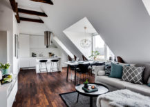 Gorgeous-attic-apartment-dining-area-is-bathed-in-ample-natural-light-217x155