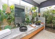 Gorgeous-tropical-bathroom-with-concrete-and-wood-vanity-and-plenty-of-greenery-217x155
