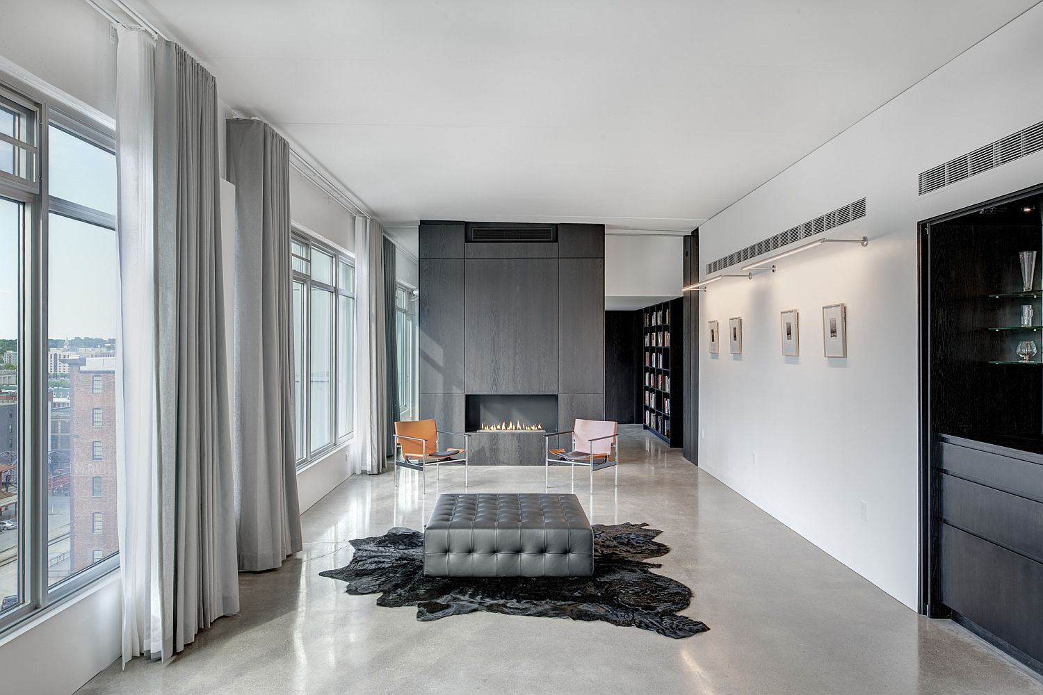 Gray accent wall in the living room with fireplace