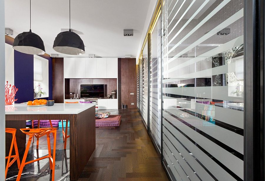 Kitchen counter and dining table rolled into one inside the colorful tiny apartmet