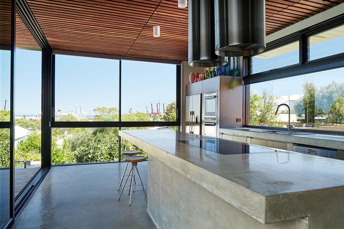 Kitchen on the top level with a view of teh harbour in the distance