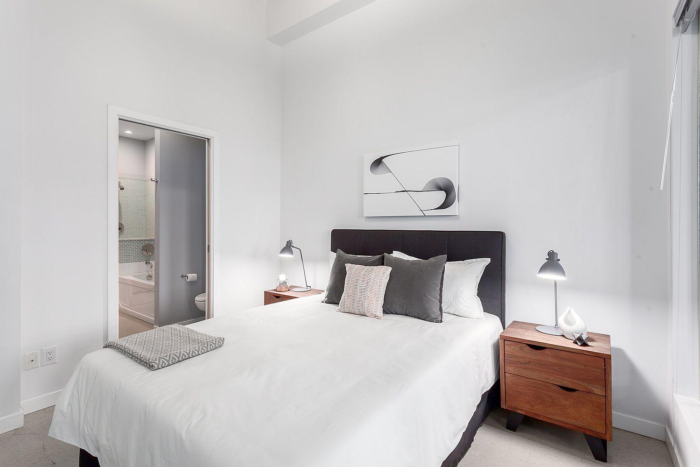 Light-filled-modern-bedroom-in-white-inside-heritage-Vancouver-apartment