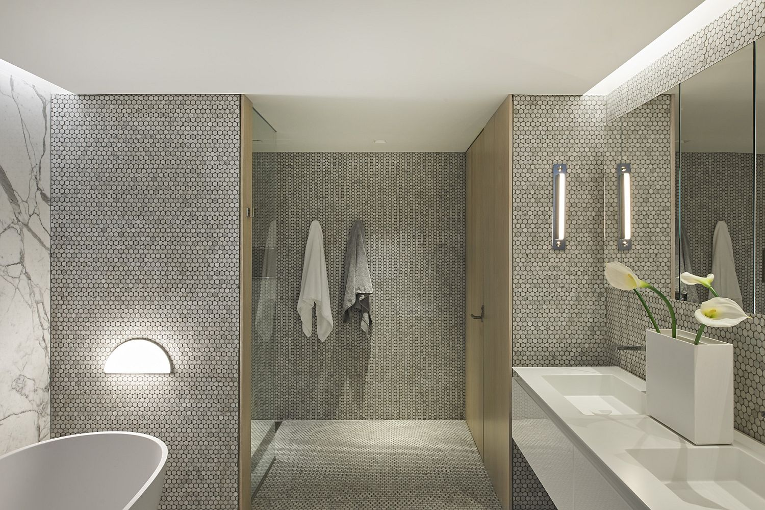 Marble and penny-tile clad gorgeous contemporary bathroom