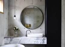 Modern-bathroom-with-concrete-walls-and-a-dashing-marble-vanity-217x155
