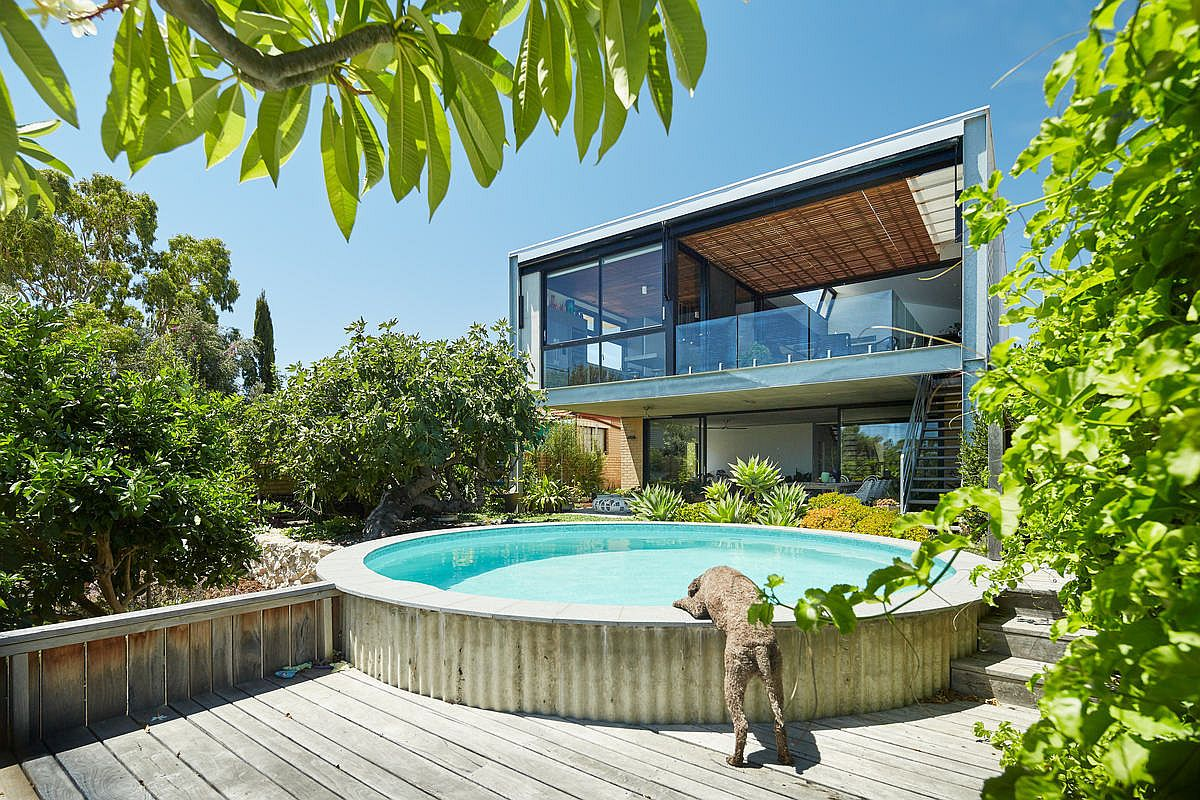Open deck and pool of the Aussie home with a view of the harbor in the distance