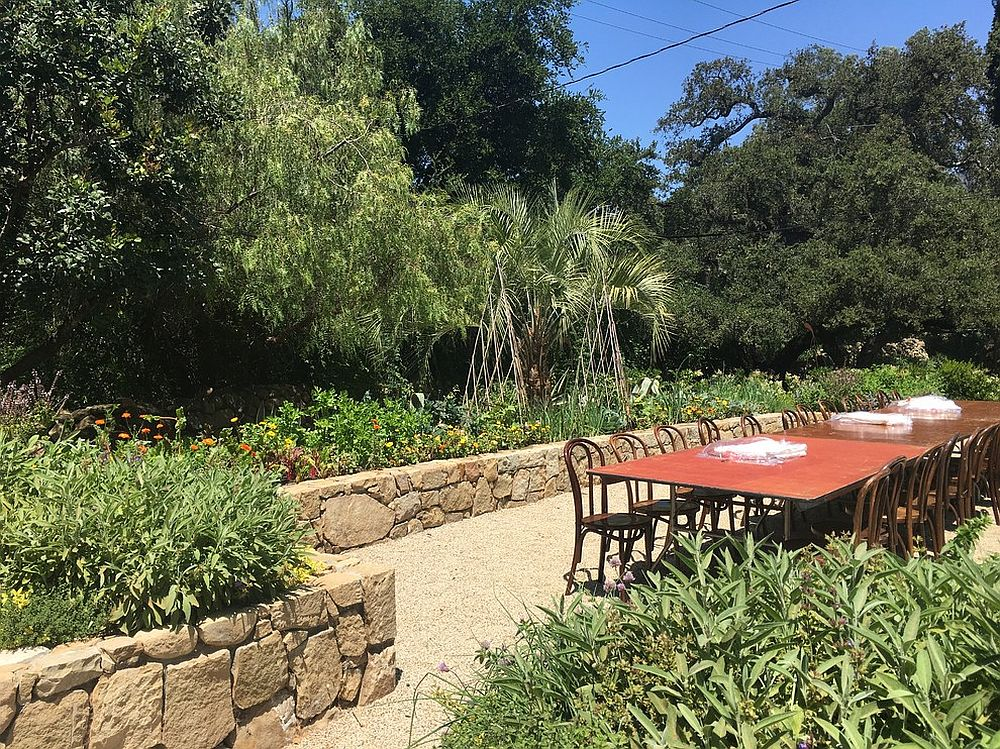 Organic edible garden with a dining area at its center