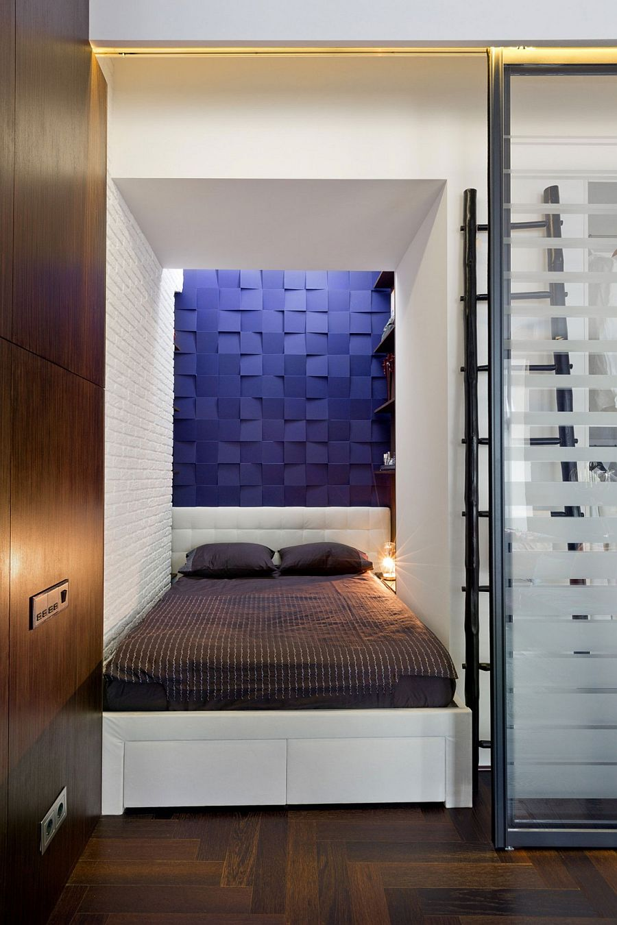 Small-niche-turned-into-a-tiny-bedroom-with-3D-blue-panels-on-the-wall