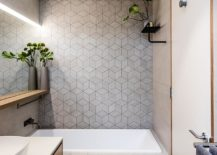 Smart-3D-style-tiled-backdrop-shapes-the-contemporary-bathroom-217x155