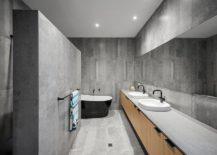 Spa-styled-minimal-bathroom-with-a-captivating-black-bathtub-217x155