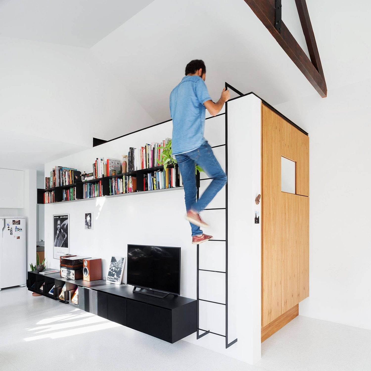 Space-above-the-bathroom-unit-used-as-a-loft-bedroom-inside-this-Sao-Paulo-apartment