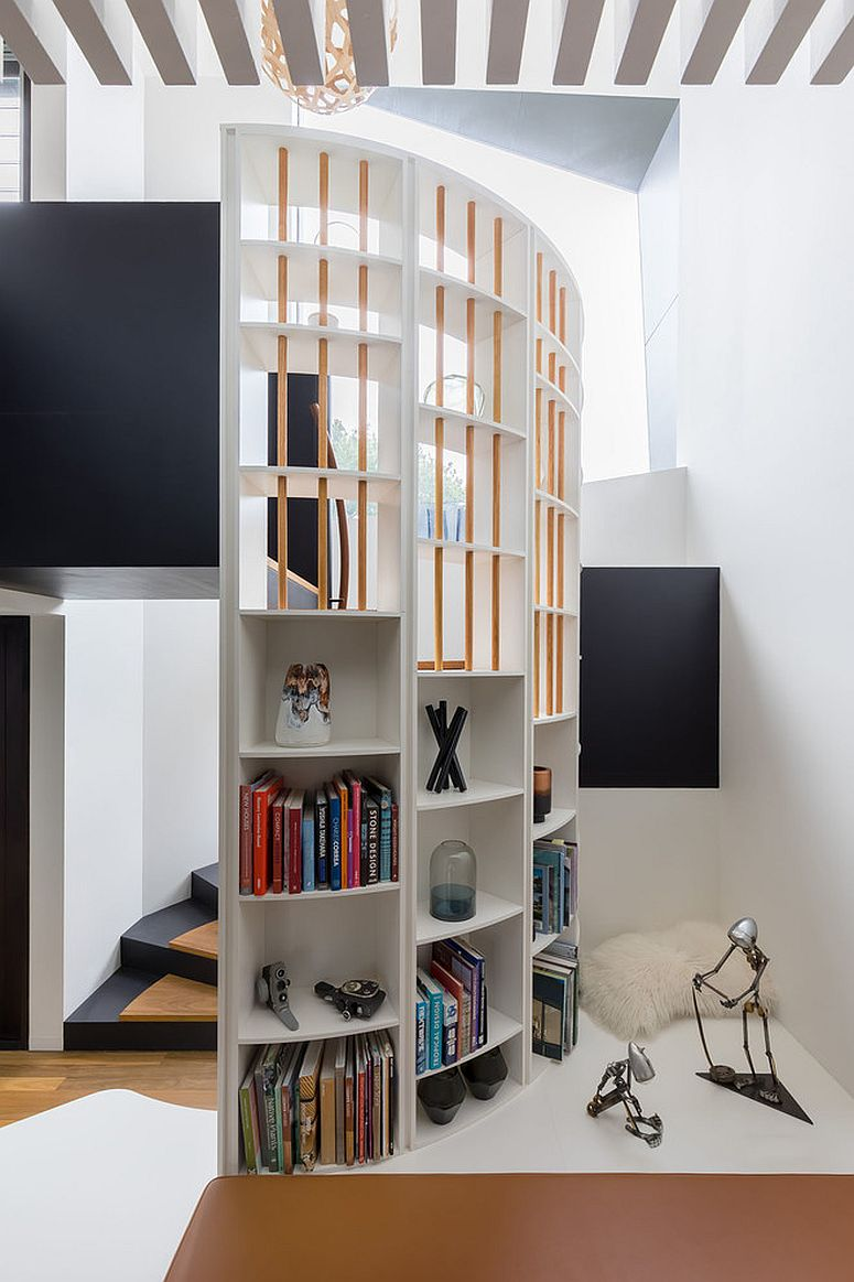 Spiral staircase can also add addition shelf space to the living room
