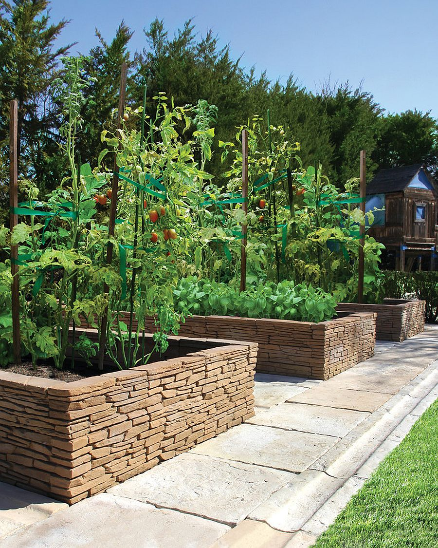 Stacked stone shapes the edible garden in this Mediterranean style setting